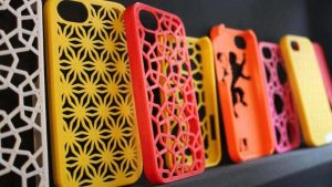 Imprimante 3D et un smartphone Apple